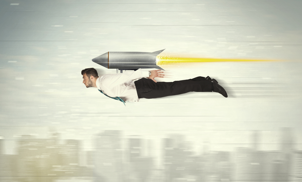 Superhero business man flying with jet pack rocket above the city concept-1